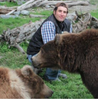 W/ orphaned Kodiak cubs (Taquka & Shaguyik) as Curator @Alaska Wildlife Conservation Center near Anchorage